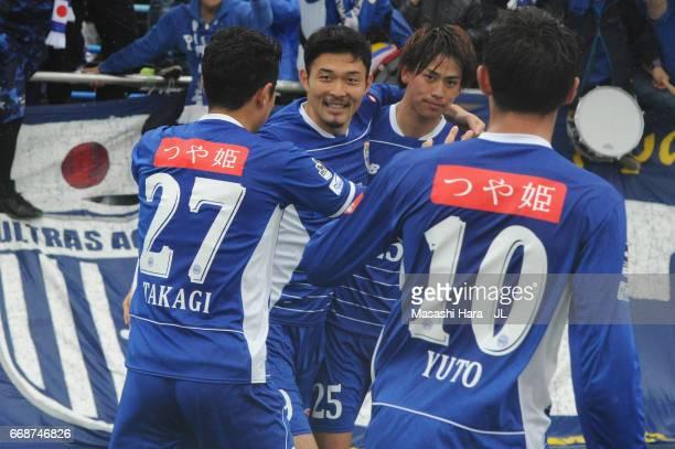 Koya Yuruki of Montedio Yamagata celebrates scoring the openig goal with his team mates during the JLeague J2 match between Montedio Yamagata and...