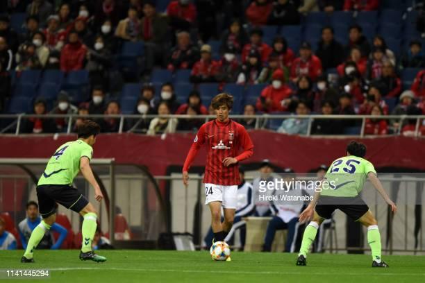 Koya Yuruki of Urawa Red Diamonds takes on Jeonbuk Hyundai Motors defense during the AFC Champions League Group G match between Urawa Red Diamonds...