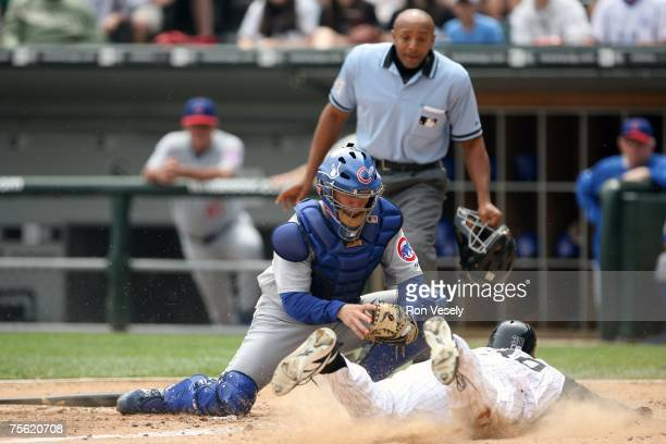 Koyie Hill of the Chicago Cubs tags out a sliding Luis Terrero during the game against the Chicago White Sox at U.S. Cellular Field in Chicago,...