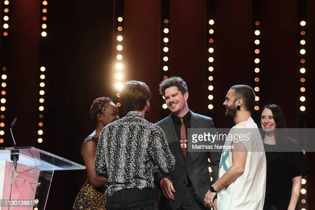 Koyo Kouoh Manuel Abramovich Jeffrey Bowers Bogdan Georgescu and Vanja Kaludjercic are seen on stage at the closing ceremony of the 69th Berlinale...