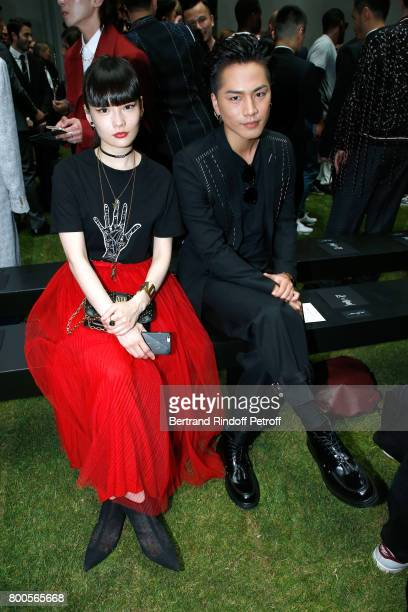 Kozue Akimoto and Hiroomi Tosaka attend the Dior Homme Menswear Spring/Summer 2018 show as part of Paris Fashion Week on June 24 2017 in Paris France