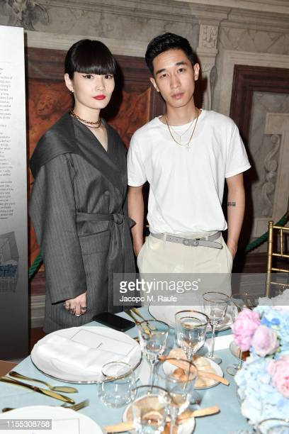 Kozue Akimoto and Keiju attends the Salvatore Ferragamo Private Dinner at Palazzo Vecchio during Pitti Immagine Uomo 96 on June 11 2019 in Florence...