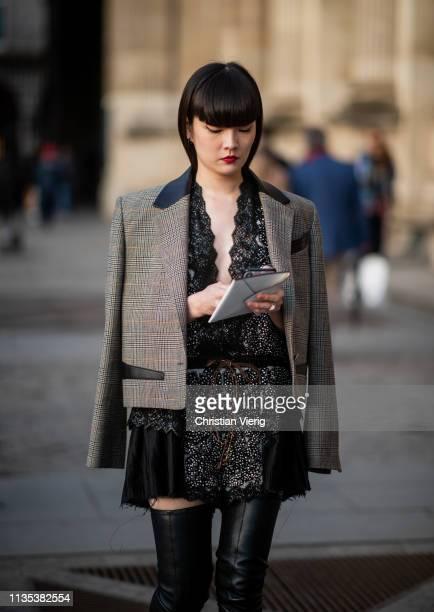 Kozue Akimoto is seen wearing dress blazer overknees boots outside Louis Vuitton during Paris Fashion Week Womenswear Fall/Winter 2019/2020 on March...