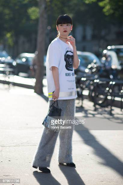 Kozue Akimoto poses after the OAMC show at the Musee National d'Art Moderne during Paris Fashion Week Menswear SS19 on June 20, 2018 in Paris,...