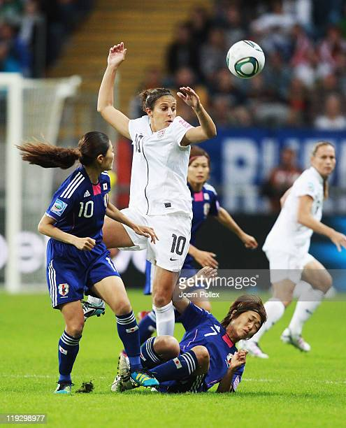 Kozue Ando and Homare Sawa of Japan and Carli Lloyd of USA battle for the ball during the FIFA Women's World Cup Final match between Japan and USA at...