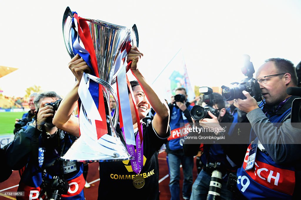 Kozue Ando of 1. FFC Frankfurt celebrates with the trophy after the UEFA Women's Champions League Final between 1. FFC Frankfurt and Paris St. Germain at Friedrich-Ludwig-Jahn Sportpark on May 14, 2015 in Berlin, Germany.