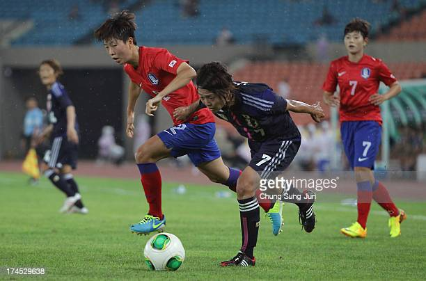 Kozue Ando of Japan and Kim HyeRi of Korea Republic compete for the ball during the EAFF Women's East Asian Cup match between Korea Republic and...