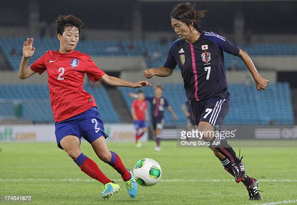 Kozue Ando of Japan compete for the ball with Kim HyeRi of South Korea during the EAFF Women's East Asian Cup match between Korea Republic and Japan...