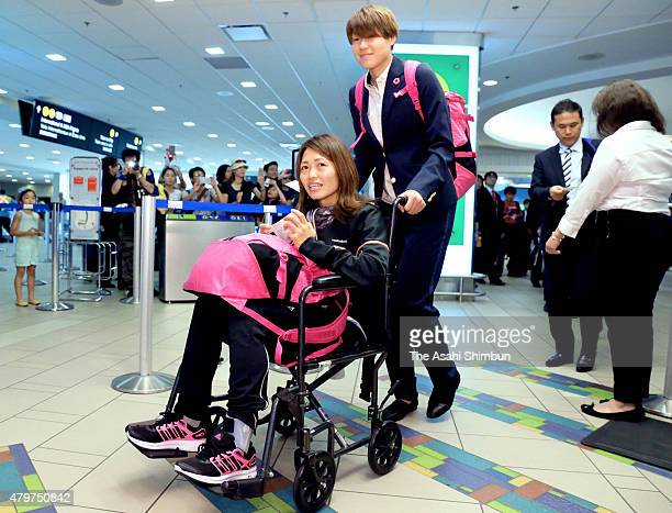Kozue Ando of Japan on the wheelchair is pushed by Erina Yamane on departure at Vancouver International Airport on July 6, 2015 in Vancouver, Canada.