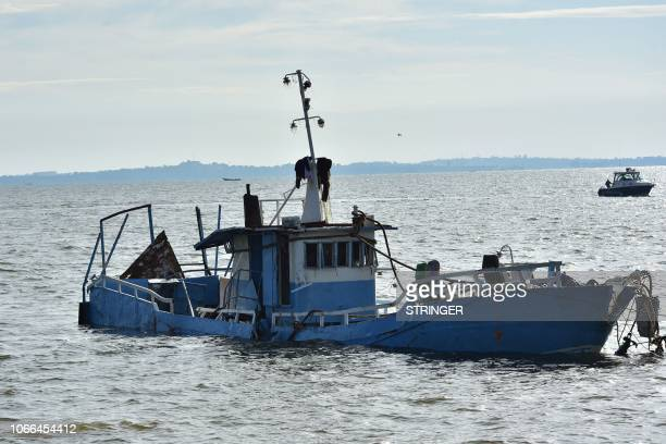 Palm the cruise boat which capsized and killed at least 32 people is salvaged by divers in Lake Victoria near Mutima village south of Kampala on...