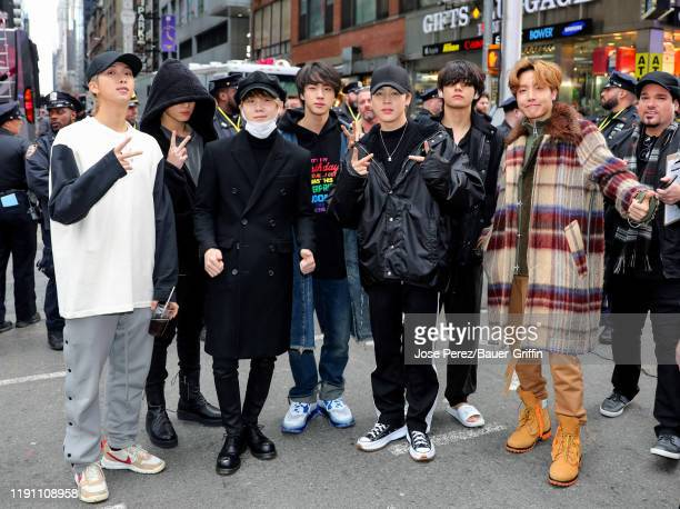 Pop band BTS is seen in Times Square on December 31 2019 in New York City