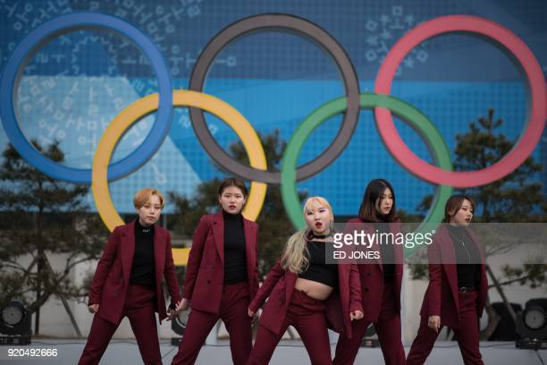 A kpop band perform at the Olympic plaza of the coastal cluster venues for the Pyeongchang Winter Olympic games in Gangneung on February 19 2018 /...