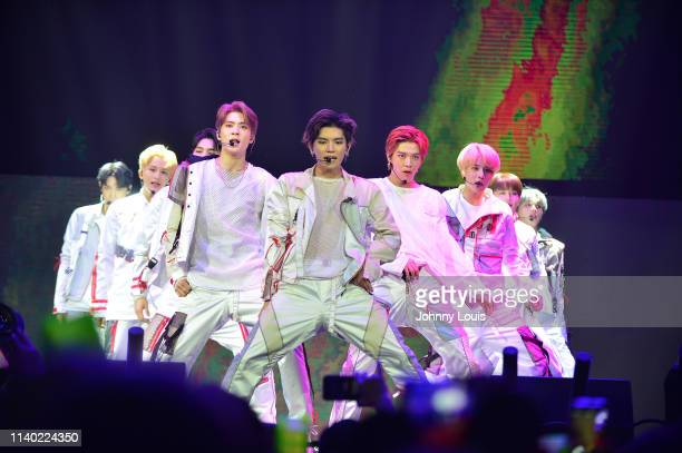 Kpop boy group NCT 127 perform during the World Tour Neo City The Origin at Watsco Center on April 27 2019 in Coral Gables Florida