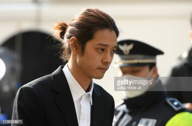 Kpop star Jung Joonyoung arrives for questioning at the Seoul Metropolitan Police Agency in Seoul on March 14 2019 A burgeoning Kpop sex scandal...