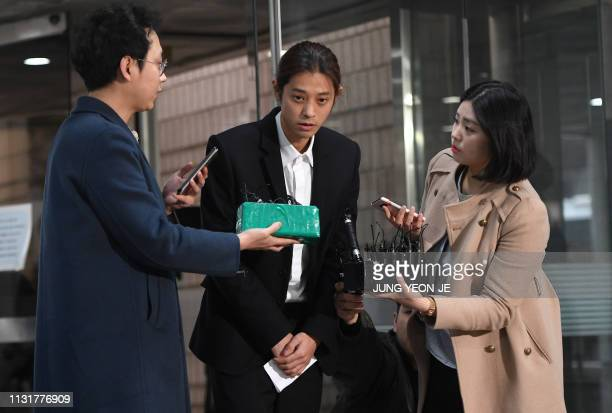 Kpop star Jung Joonyoung arrives to attend a hearing on his arrest warrant at the Seoul central district court in Seoul on March 21 2019 South Korean...