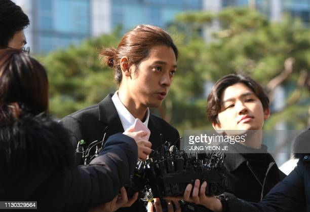 Pop star Jung Joon-young speaks to the media as he arrives for questioning at the Seoul Metropolitan Police Agency in Seoul on March 14, 2019. - A...