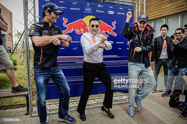 "Pop star Psy performs the ""Gangnam style"" dance with Red Bull-Renault driver Mark Webber of Australia and Red Bull-Renault driver Sebastian Vettel of..."
