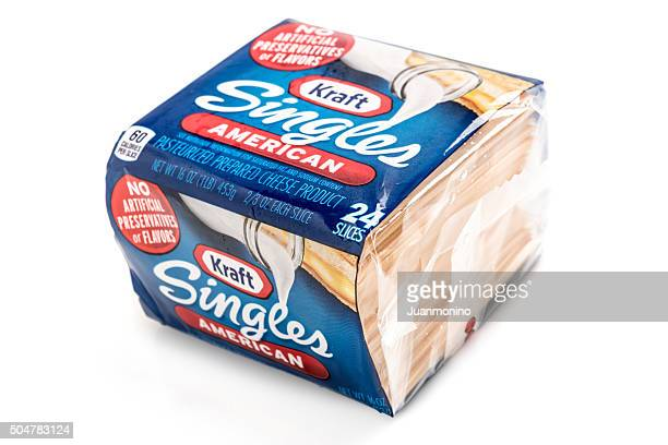 kraft brand single slices of american cheese - kraft foods stock photos and pictures
