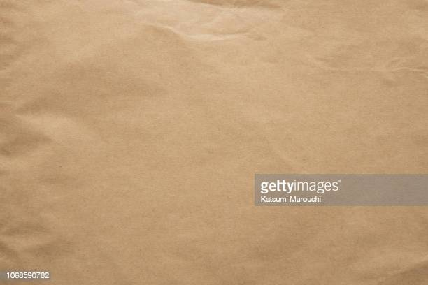 kraft brown paper texture background - brown paper stock pictures, royalty-free photos & images