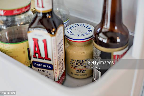 Kraft Foods Group Inc A1 steak sauce and Grey Poupon dijon mustard are arranged for a photograph in Tiskilwa Illinois US on Tuesday Feb 10 2015 Kraft...
