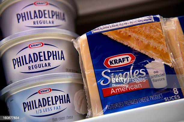 Kraft Foods Group Inc Philadelphia cream cheese tubs and American cheese single cheese packages are arranged for a photograph in Fog Hill Market in...