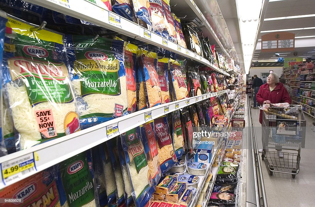 Kraft Foods Inc. cheeses are in a grocery store refrigerator : News Photo