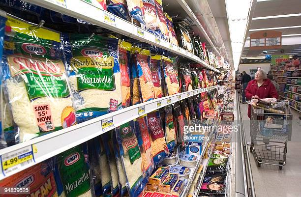 Kraft Foods Inc cheeses are in a grocery store refrigerator case in Wilmette Illinois on Tuesday April 20 2004 Altria Group Inc the parent company of...