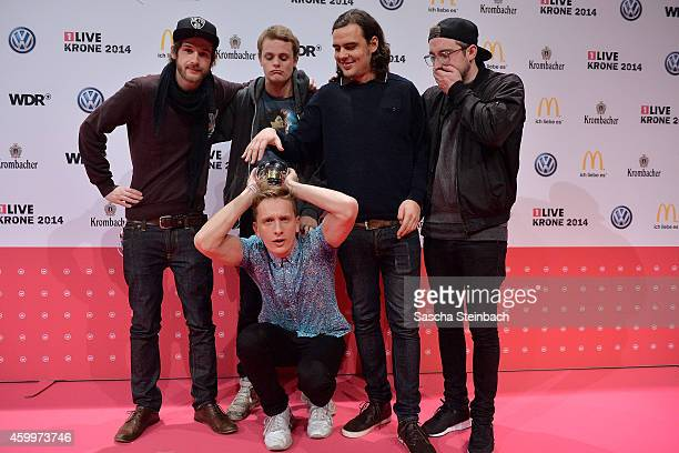 'Kraftklub' poses with the award during the 1Live Krone 2014 at Jahrhunderthalle on December 4 2014 in Bochum Germany