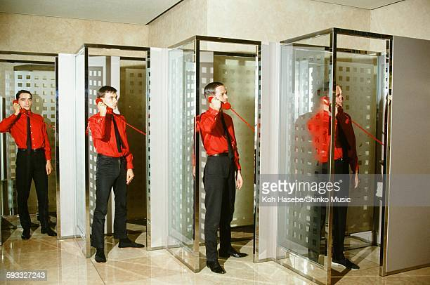 Kraftwerk standing in phone booth in Keio Plaza Hotel Tokyo September 1981