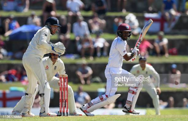 Kraigg Brathwaite of West Indies plays a shot as Jonny Bairstow of England looks on during Day Two of the 2nd Test match between West Indies and...
