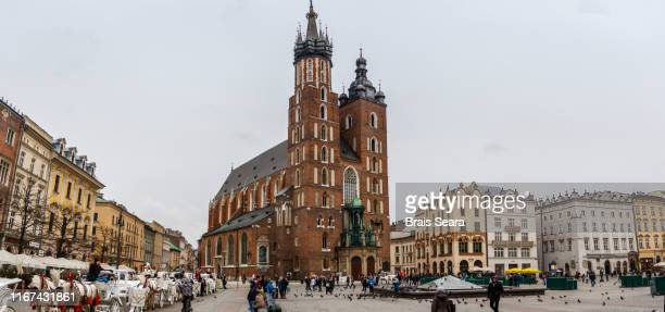 krakow main market square with st. mary's basilica. - vintage stock stock pictures, royalty-free photos & images