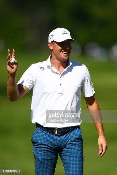 Kramer Hickok of the United States reacts after a double eagle on the fourth hole during the second round of the RBC Canadian Open at Hamilton Golf...