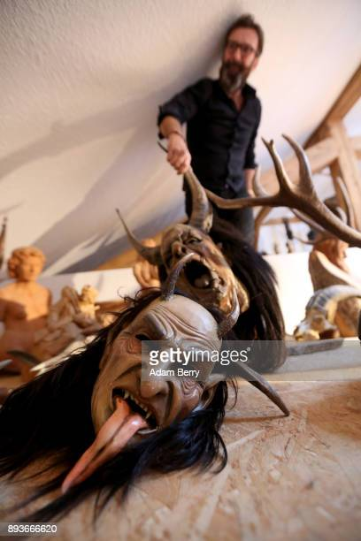Krampus mask lies on the floor of the attic of the workshop belonging to sculptor and woodworker Rupert Kreuzer on December 15 2017 in Grossarl near...