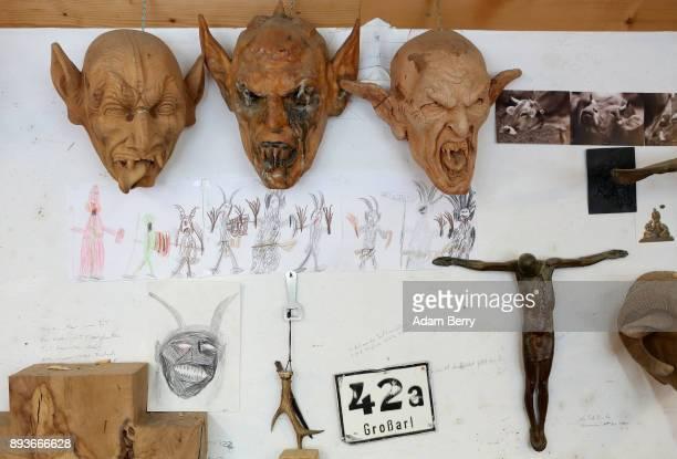 Krampus masks hang in the workshop belonging to sculptor and woodworker Rupert Kreuzer on December 15 2017 in Grossarl near Salzburg Austria Krampus...