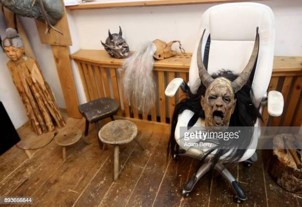 Krampus masks sits in an armchair in the workshop belonging to sculptor and woodworker Rupert Kreuzer on December 15 2017 in Grossarl near Salzburg...