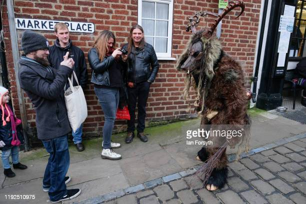 Krampus participant interacts with members of the public as he walks through the streets during the annual Whitby Krampus parade on December 07 2019...