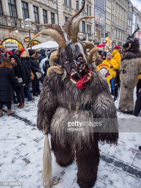 Krampuslauf or Perchtenlauf during advent in Munich an old tradition taking place during christmas time in the alps of Bavaria Austria and South...