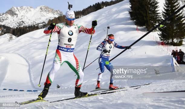 Krasimir Anev of Bulgaria and Ondrej Moravec of Czech Republic compete in the Men's 125 km Pursuit race during the 2017 IBU Biathlon World...
