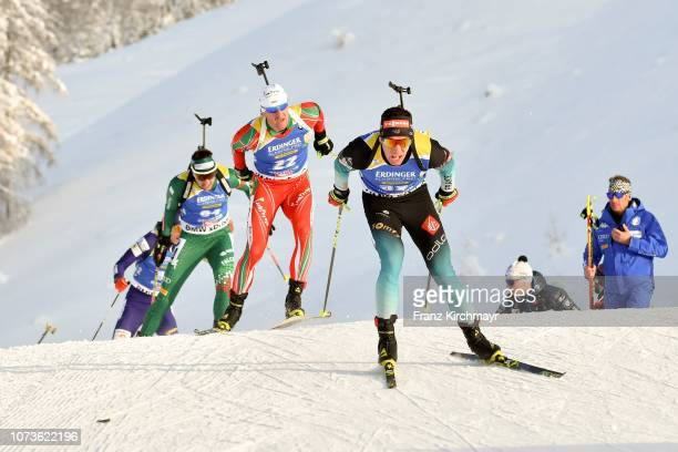Krasimir Anev of Bulgaria and Quentin Fillon Maillet of France during the Men 125 km Pursuit Competition at Biathlon Stadium Hochfilzen on December...