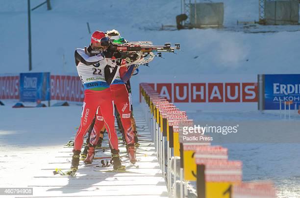Krasimir Anev on the shooting range during Biathlon World Cup 15km Mass Start Men on Pokljuka 2014