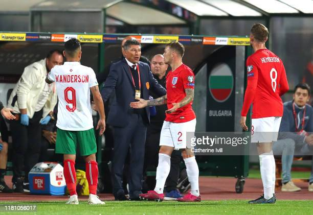 Krasimir Balakov, Manager of Bulgaria speaks with Kieran Trippier of England during the UEFA Euro 2020 qualifier between Bulgaria and England on...