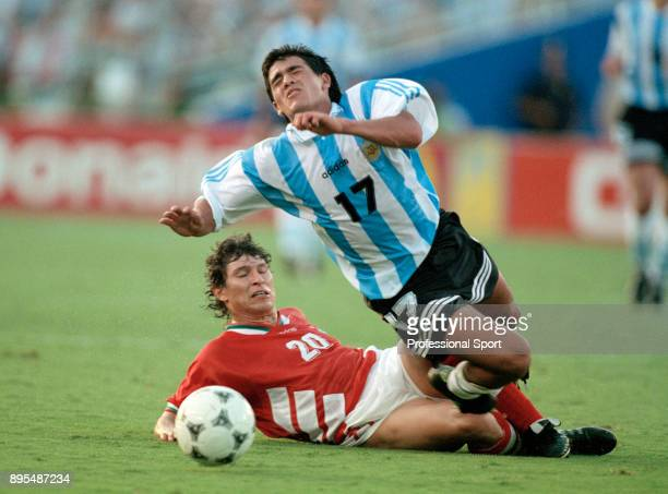 Krasimir Balakov of Bulgaria brings down Ariel Ortega of Argentina during a 1994 FIFA World Cup group game at the Cotton Bowl on June 30 1994 in...
