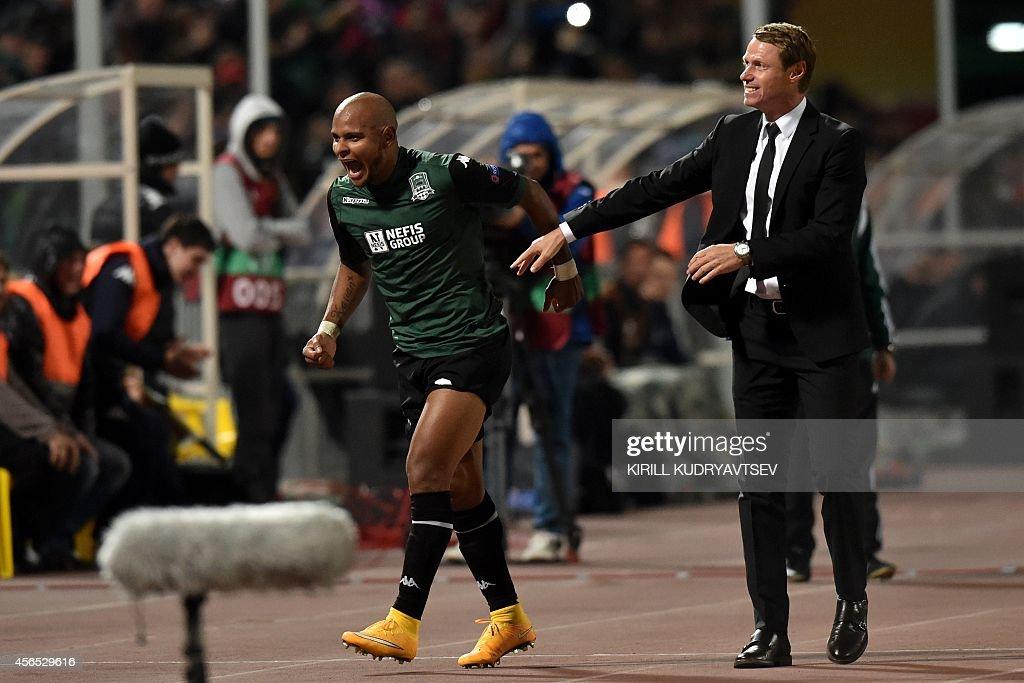 FC Krasnodar's Ari (L) is congratulated by his coach Oleg Kononov (R) after scoring a goal during UEFA Europe League group H football match between FC Krasnodar and FC Everton in Krasnodar on October 2, 2014.