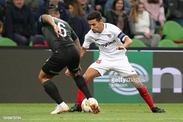 FK Krasnodar's Ecuadorian defender Cristian Ramirez and Sevilla's Spanish midfielder Jesus Navas vie for the ball during the UEFA Europa League group...
