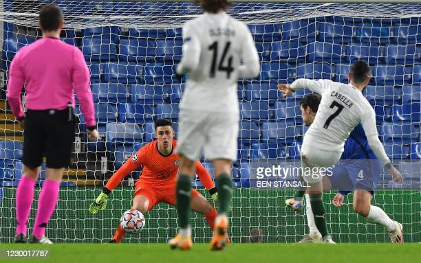 Krasnodar's French midfielder Remy Cabella scores the opening goal past Chelsea's Spanish goalkeeper Kepa Arrizabalaga during the UEFA Champions...