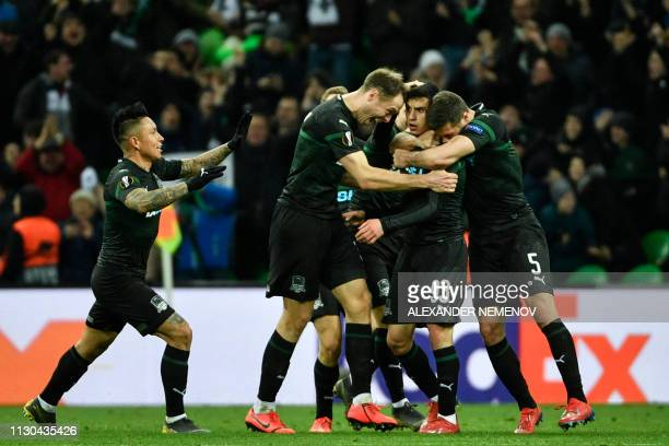 FC Krasnodar's players celebrate a goal scored by FC Krasnodar's Russian forward Magomed Suleymanov during the UEFA Europa League round of 16 second...