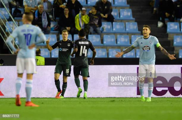 FC Krasnodar's players celebrate after scoring during the UEFA Europa League round of 16 first leg football match RC Celta de Vigo vs FC Krasnodar at...
