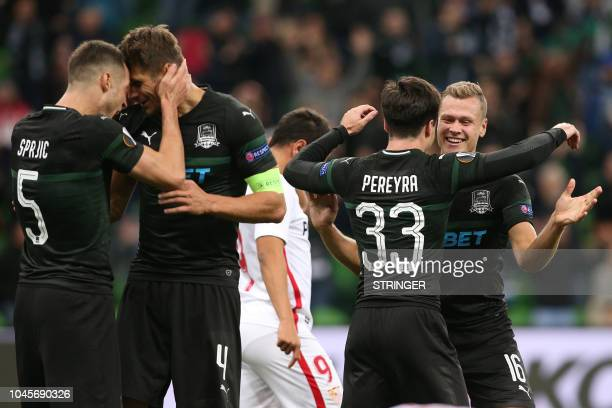 Krasnodar's players celebrate after winning the UEFA Europa League group J football match between FC Krasnodar and Sevilla FC in Krasnodar on October...