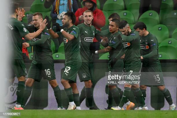 Krasnodar's players celebrate the opening goal scored by Swedish forward Marcus Berg during the UEFA Champions League football match between FK...