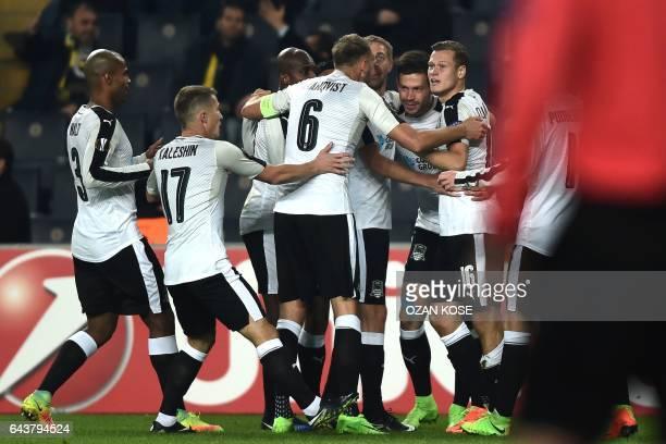 Krasnodar's Russian forward Fyodor Smolov celebrates with temmates after scoring a goal during the UEFA Europa League round of 32 second leg football...